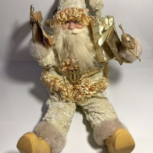 Santa Figure Holding Gifts, Maps and a Christmas T